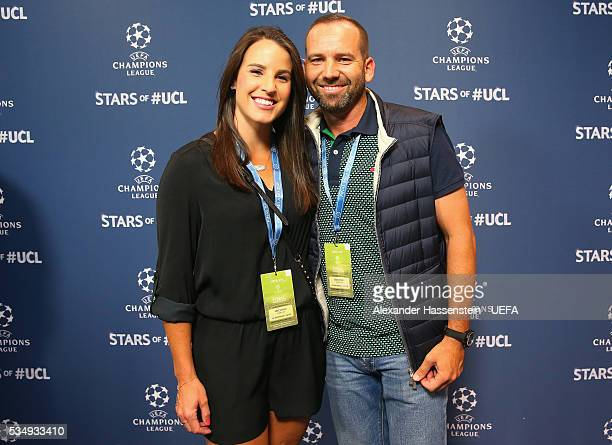 Golf player Sergio Garcia and Angela Akins attend the UEFA Champions League Final between Real Madrid and Club Atletico de Madrid at Stadio Giuseppe...