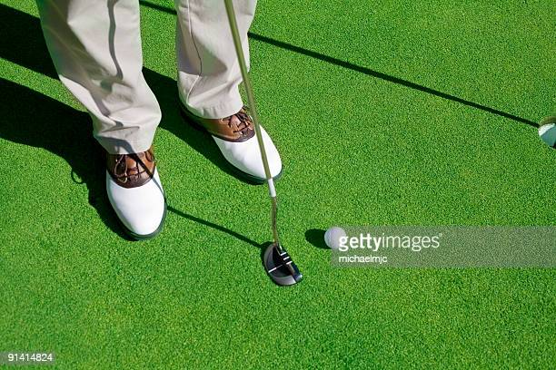 Golf player trying to make the putt