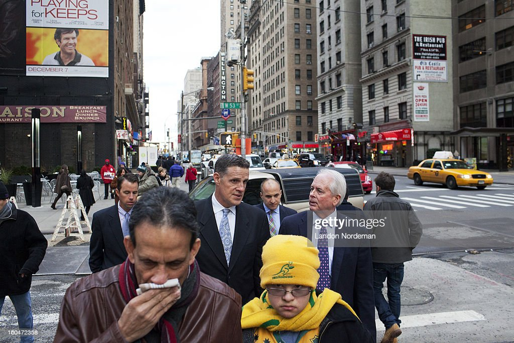 Portrait of PGA of America president Ted Bishop speaking to Kevin Carter, Managing Director Business Development at PGA of America, while walking down Seventh Avenue at 53rd Street. Landon Nordeman F825 )