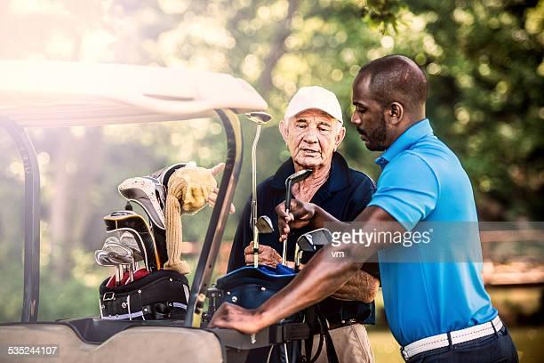Golf Pro Teaching Male Golfer