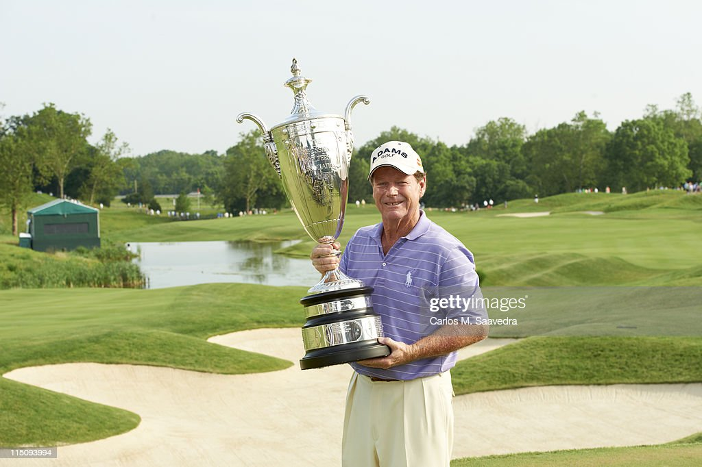 Tom Watson victorious with trophy after winning tournament on Sunday at Valhalla GC. Champions Tour. Carlos M. Saavedra F69 )
