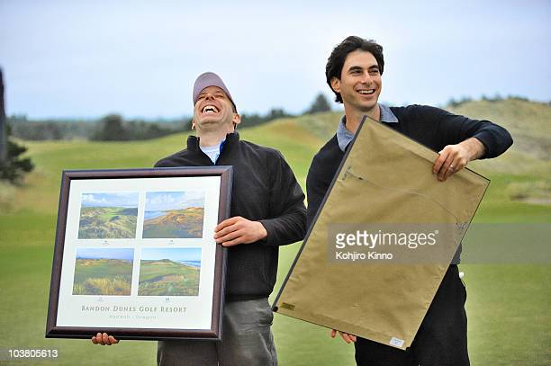 Sports Illustrated senior writer Alan Shipnuck and Kevin Price receiving framed gifts after playing 72 holes of golf at Bandon Dunes Golf Resort...