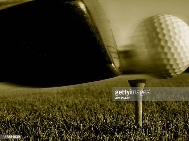 Golf swing - ball in motion sepia