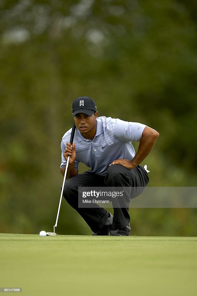 The Barclays Tiger Woods in action missing putt on No 17 during Thursday play at Liberty National GC FedEx Cup Jersey City NJ 8/27/2009 CREDIT Mike...