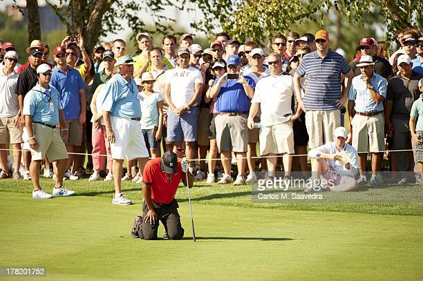 The Barclays Tiger Woods on his knees after suffering back spasms on No 13 hole during Sunday play at Liberty National GC FedEx Cup Sequence Jersey...