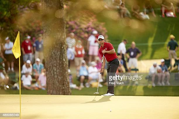 The Masters Adam Scott in action putt with anchored putter on No 15 green during Friday play at Augusta National Augusta GA CREDIT Fred Vuich