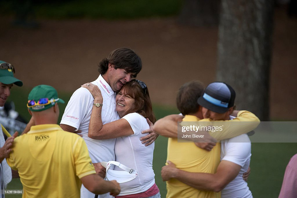 Bubba Watson victorious with mother Molly Marie Watson after winning tournament on Sunday on hole No 10 at Augusta National. John Biever F357 )