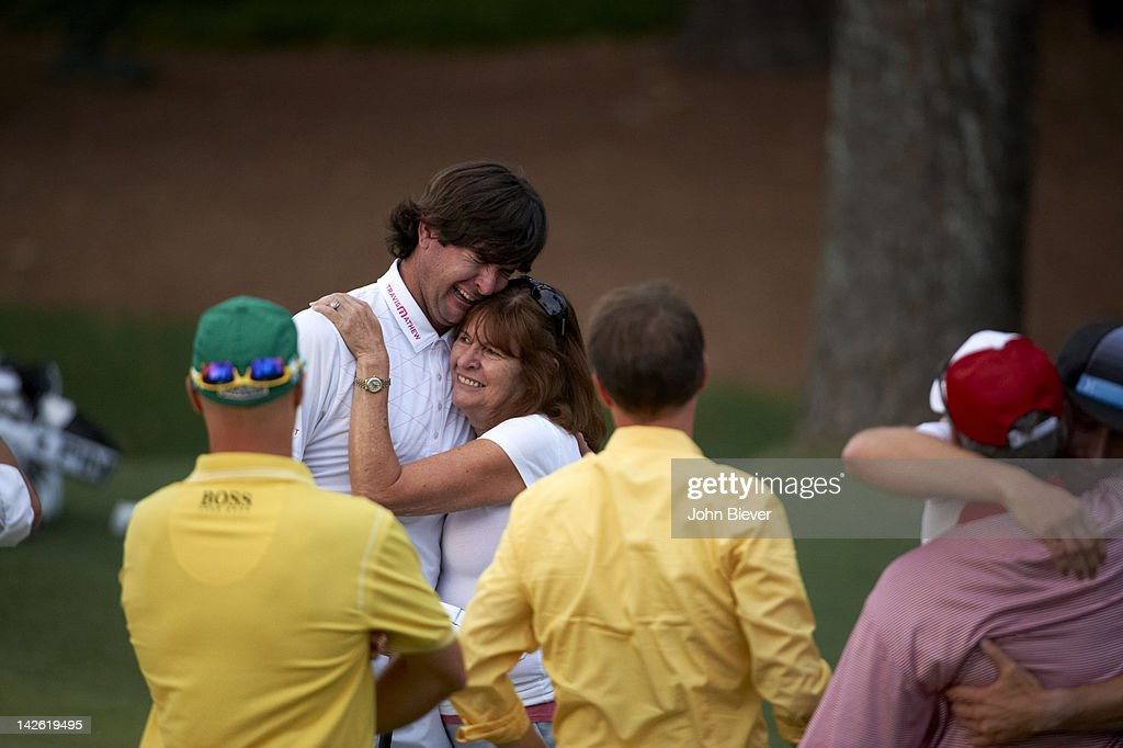 Bubba Watson victorious with mother Molly Marie Watson after winning tournament on Sunday on hole No 10 at Augusta National. John Biever F368 )