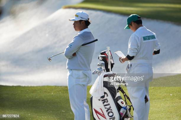 The Masters Hideki Matsuyama looks on with caddie during Friday play at Augusta National Augusta GA CREDIT Al Tielemans