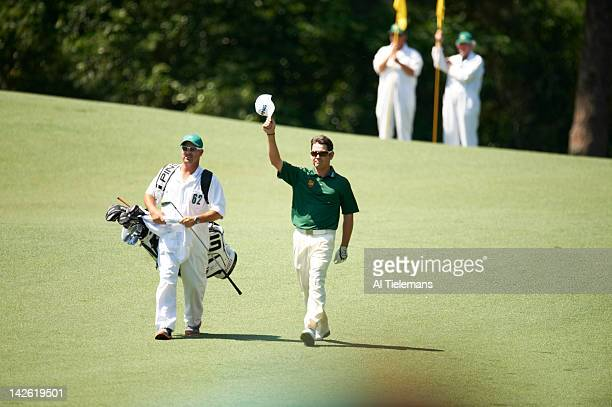 The Masters Louis Oosthuizen and caddie Wynand Stander victorious after double eagle on No 2 hole during Sunday play at Augusta National Scenic...