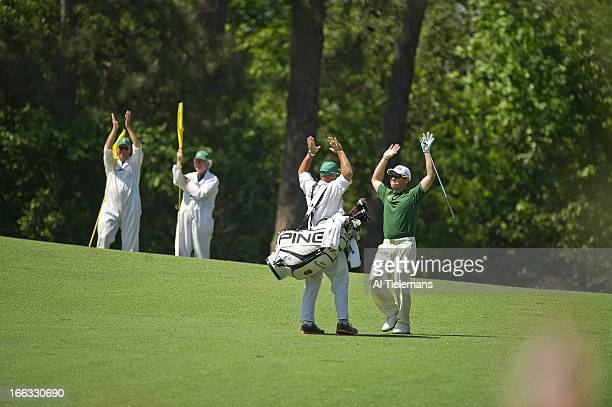 The Masters Louis Oosthuizen and caddie Wynand Stander victorious after double eagle on No 2 hole during Sunday play at Augusta National Augusta GA...