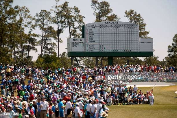 The Masters Overall view of Rory McIlroy in action drive from No 3 tee during Sunday play at Augusta National View of leaderboard in background...