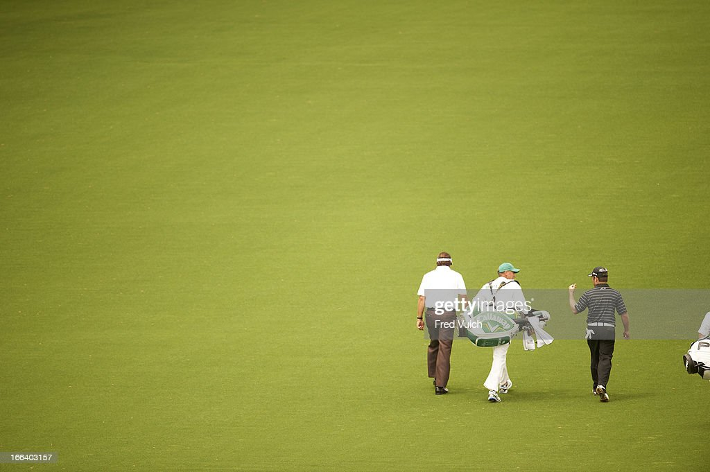 Phil Mickelson and Louis Oosthuizen walk along No 1 fairway during Thursday play at Augusta National. Fred Vuich F149 )