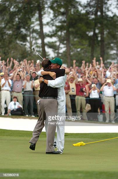 The Masters Phil Mickelson victorious hugging caddie Jim 'Bones' Mackay after winning tournament on Sunday at Augusta National Augusta GA CREDIT Fred...