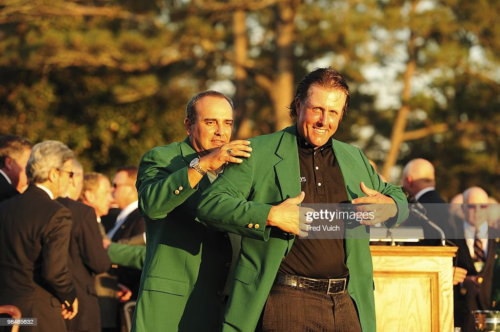 Phil Mickelson victorious wearing green blazer with Angel Cabrera during jacket ceremony after winning tournament on Sunday at Augusta National. Augusta, GA 4/11/2010