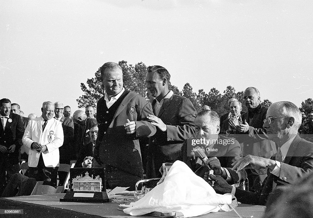 Previous year's winner Arnold Palmer helping winner Jack Nicklaus into green blazer at Augusta National Golf Course. Augusta, GA 4/7/1963 Credit: James Drake