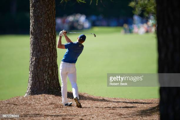The Masters Rear view of Jordan Spieth in action on No 13 hole during Saturday play at Augusta National Augusta GA CREDIT Robert Beck