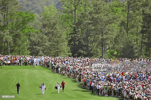 The Masters Scenic view of Tiger Woods with caddie Steve Williams and Phil Mickelson with caddie Jim Mackay walking during Sunday play at Augusta...