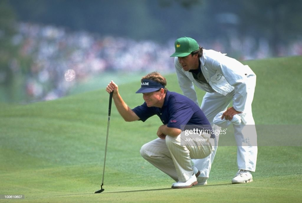 Tom Watson lining up putt during tournament at Augusta National. Augusta, GA 4/9/1994--4/10/1994