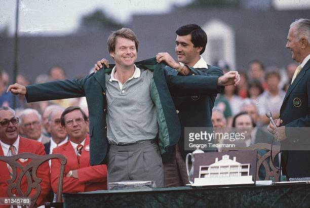 Golf The Masters Tom Watson victorious with trophy green blazer and Seve Ballesteros after winning tournament on Sunday at Augusta National Augusta...