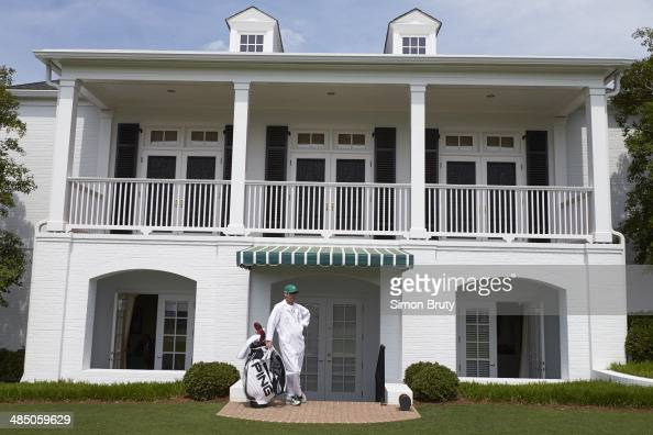 The Masters View of caddie standing in front of clubhouse during Friday play at Augusta National Augusta GA CREDIT Simon Bruty