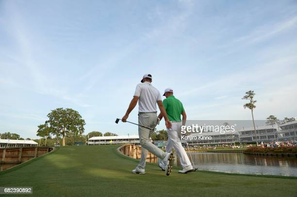 The Players Championship Rear view of Dustin Johnson and Justin Thomas walking on No 17 green during Thursday play at TPC Sawgrass Ponte Vedra Beach...