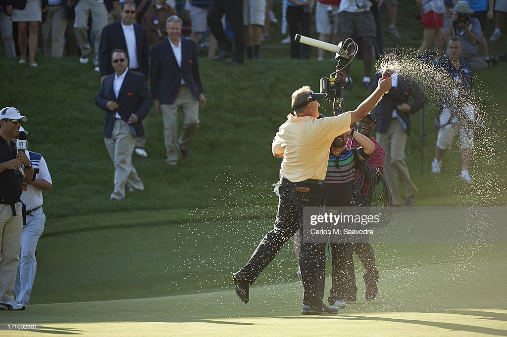 Ken Duke victorious, spraying soda after winning tournament on second playoff hole on Sunday at TPC River Highlands. Carlos M. Saavedra F708 )