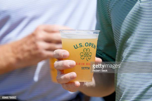 US Open Closeup of spectator holding plastic glass of beer during Friday play at Erin Hills GC Hartford WI CREDIT Kohjiro Kinno