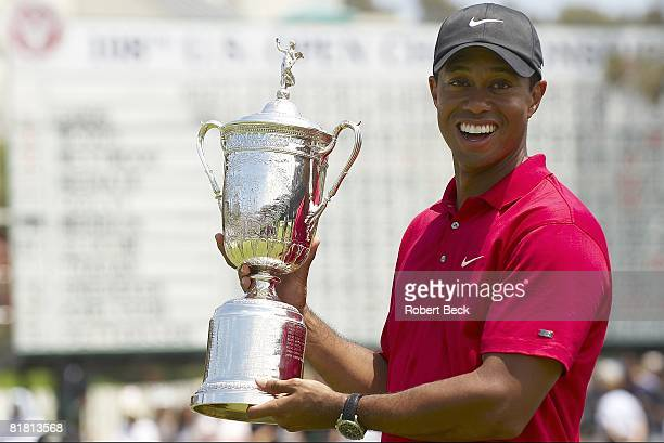 US Open Closeup of Tiger Woods victorious with trophy after winning Monday playoff round vs Rocco Mediate at Torrey Pines GC La Jolla CA 6/16/2008...
