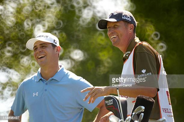 Wells Fargo Championship Jim 'Bones' Mackay caddie of Phil Mickelson laughing with Gary Woodland during Thursday play at Quail Hollow Club Charlotte...