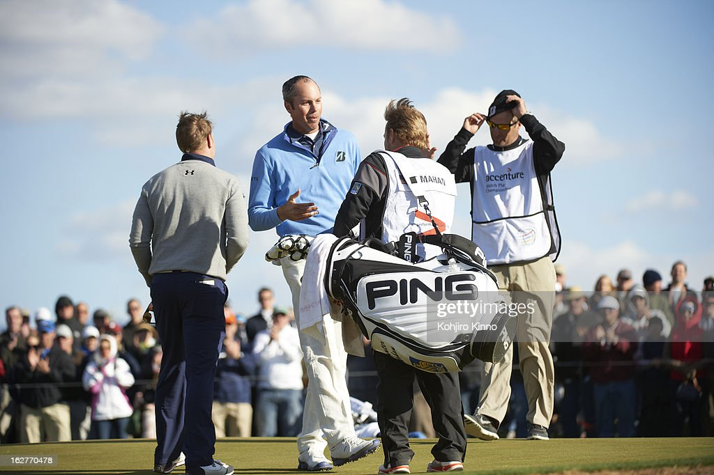 Matt Kuchar shaking hands with John Wood, caddie for Hunter Mahan, after winning tournament on Sunday at Ritz-Carlton GC of Dove Mountain. Kohjiro Kinno F220 )