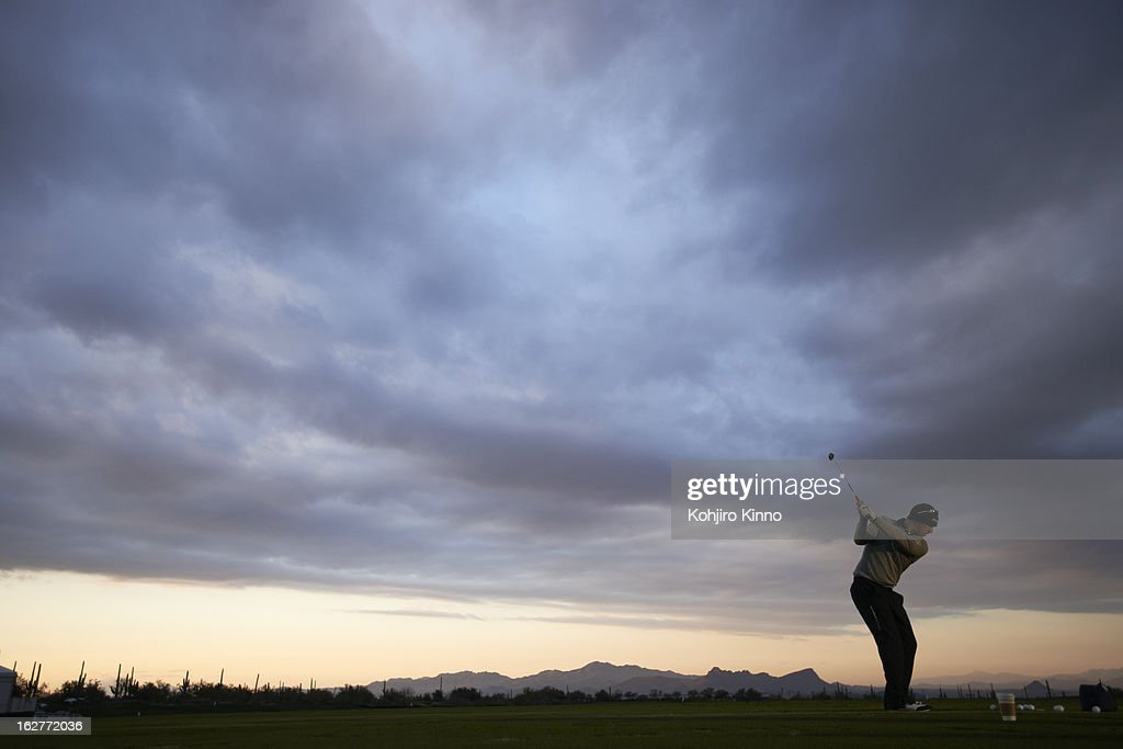 Scenic view of Hunter Mahan in action on practice range before semifinal on Sunday at Ritz-Carlton GC of Dove Mountain. Kohjiro Kinno F22 )