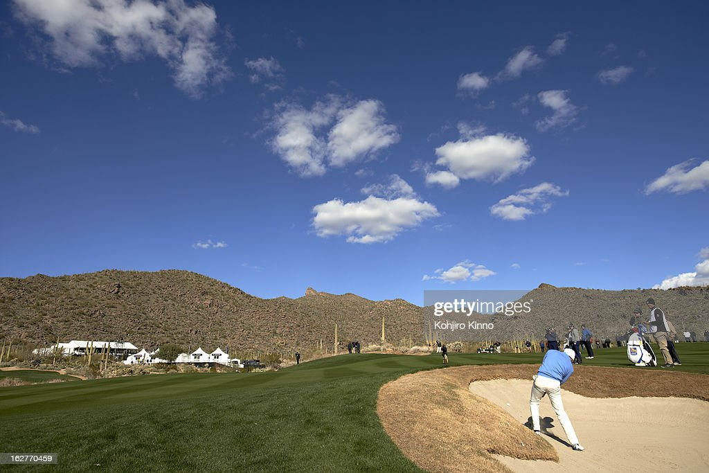 Scenic view of Matt Kuchar in action from sand during Sunday play at Ritz-Carlton GC of Dove Mountain. Kohjiro Kinno F7 )