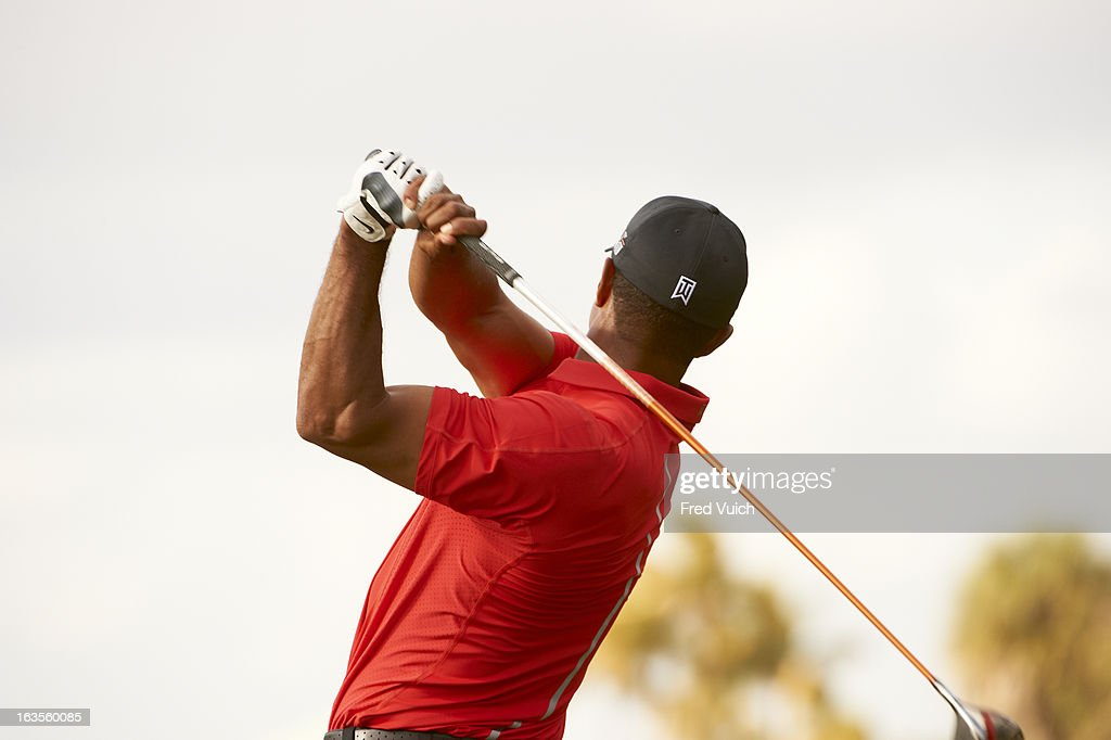 Closeup from rear of Tiger Woods in action, drive during Sunday play at TPC Blue Monster Course of Doral Resort & Spa. Fred Vuich F154 )