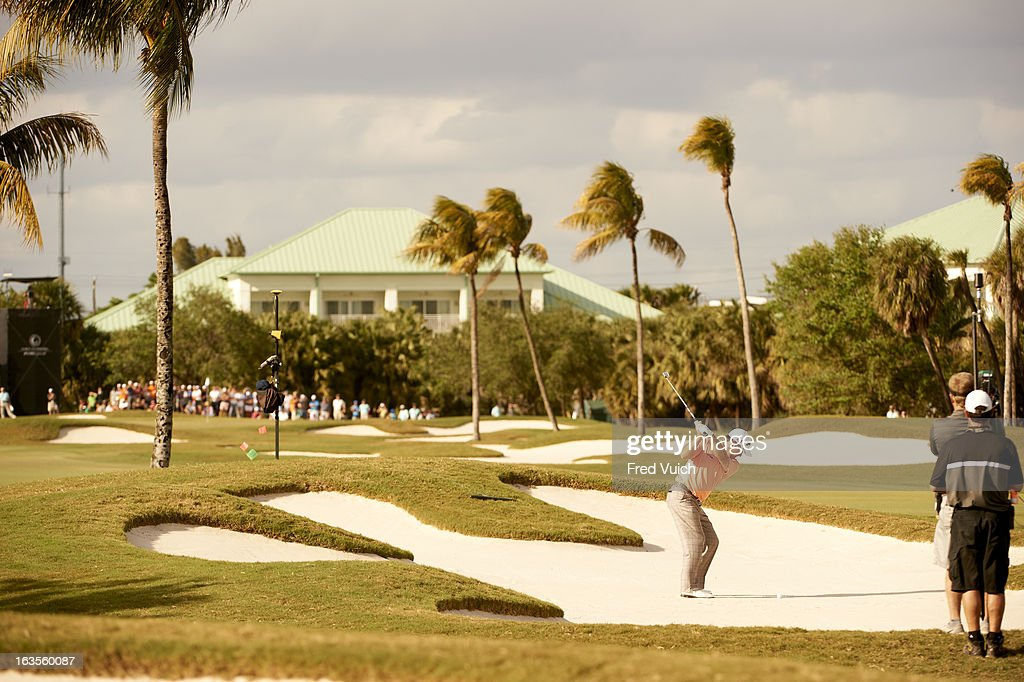 Graeme McDowell in action from sand during Sunday play at TPC Blue Monster Course of Doral Resort & Spa. Fred Vuich F170 )