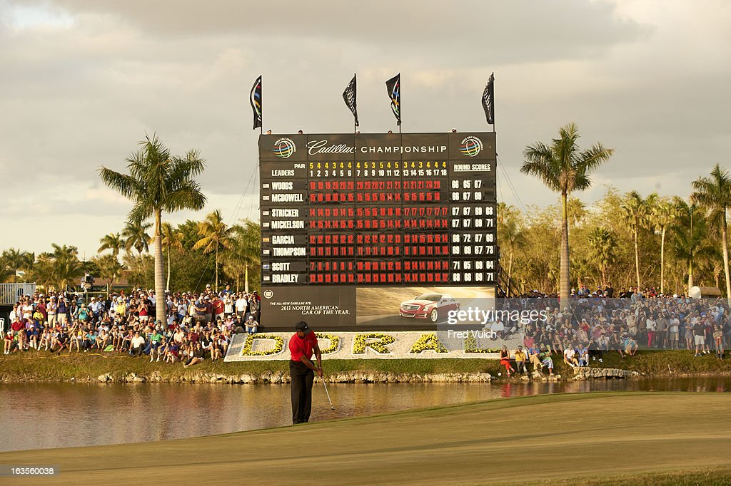 Overall view of Tiger Woods in action from No 18 hole during Sunday play at TPC Blue Monster Course of Doral Resort & Spa. View of leaderboard. Fred Vuich F147 )