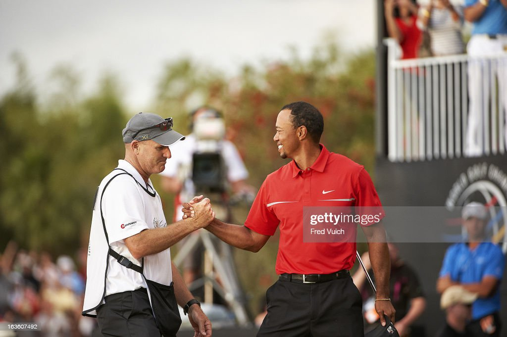 Tiger Woods victorious with caddie Joe LaCava after winning tournament on Sunday at TPC Blue Monster Course of Doral Resort & Spa. Fred Vuich F286 )