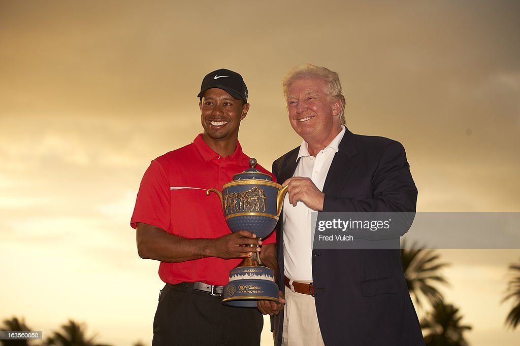 Tiger Woods victorious with Donald Trump, holding Gene Sarazen Cup trophy after winning tournament on Sunday at TPC Blue Monster Course of Doral Resort & Spa. Trump is the owner of the Doral Resort. Fred Vuich F178 )