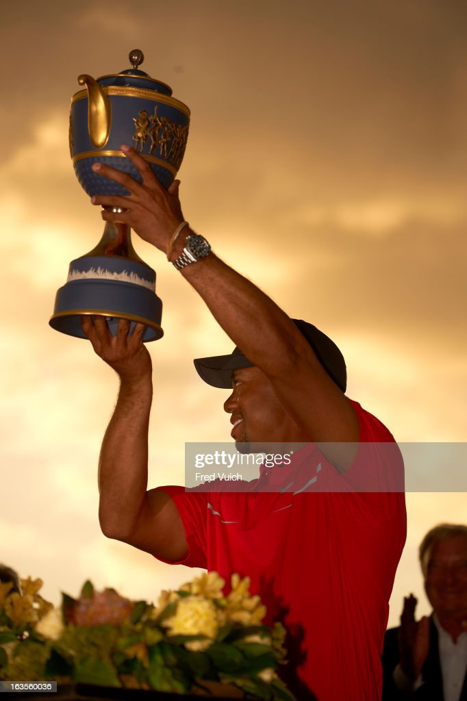 Tiger Woods victorious with Gene Sarazen Cup trophy after winning tournament on Sunday at TPC Blue Monster Course of Doral Resort & Spa. Fred Vuich F152 )