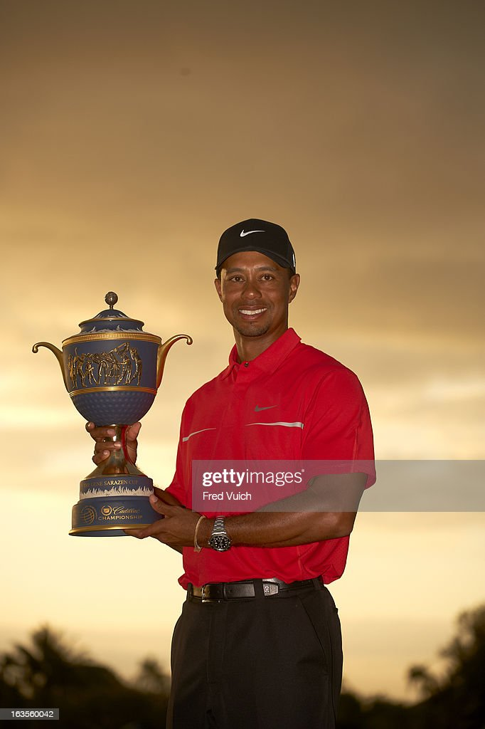 Tiger Woods victorious with Gene Sarazen Cup trophy after winning tournament on Sunday at TPC Blue Monster Course of Doral Resort & Spa. Fred Vuich F155 )