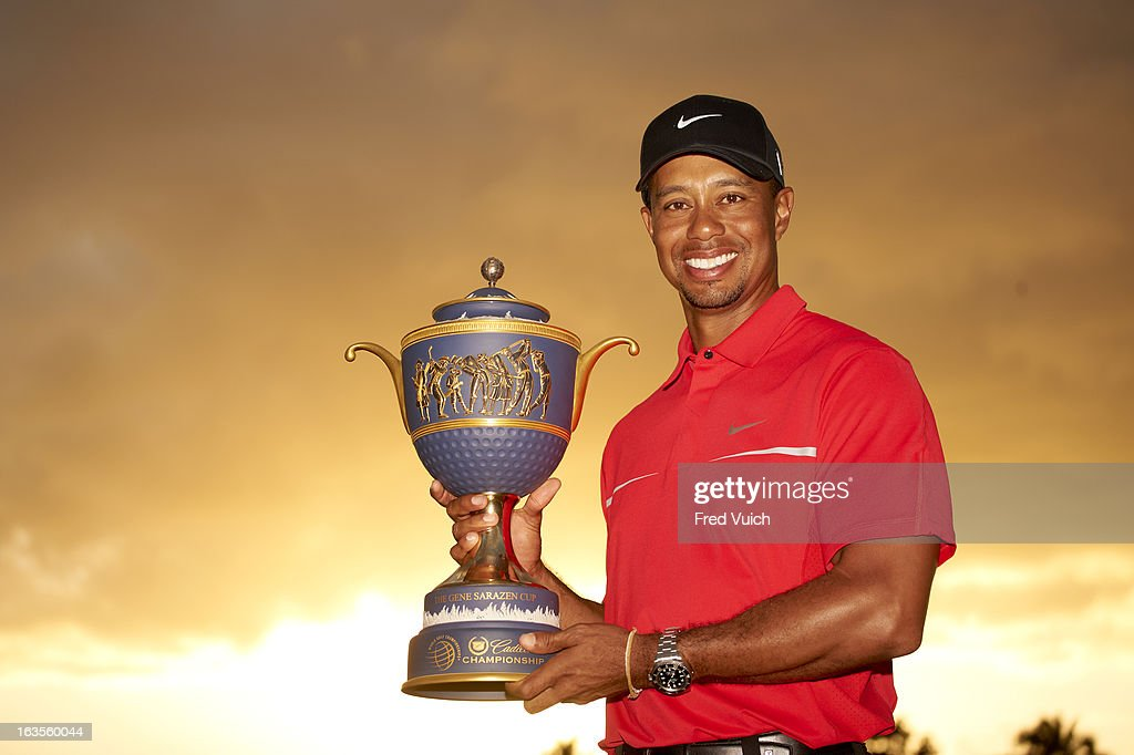 Tiger Woods victorious with Gene Sarazen Cup trophy after winning tournament on Sunday at TPC Blue Monster Course of Doral Resort & Spa. Fred Vuich F171 )