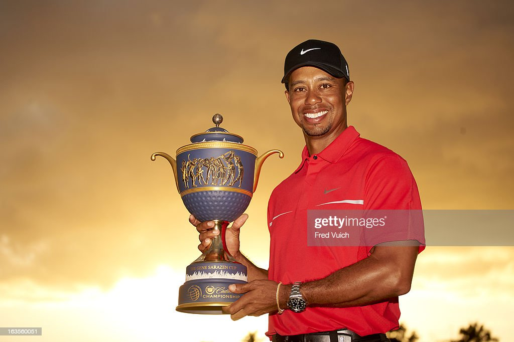 Tiger Woods victorious with Gene Sarazen Cup trophy after winning tournament on Sunday at TPC Blue Monster Course of Doral Resort & Spa. Fred Vuich F182 )