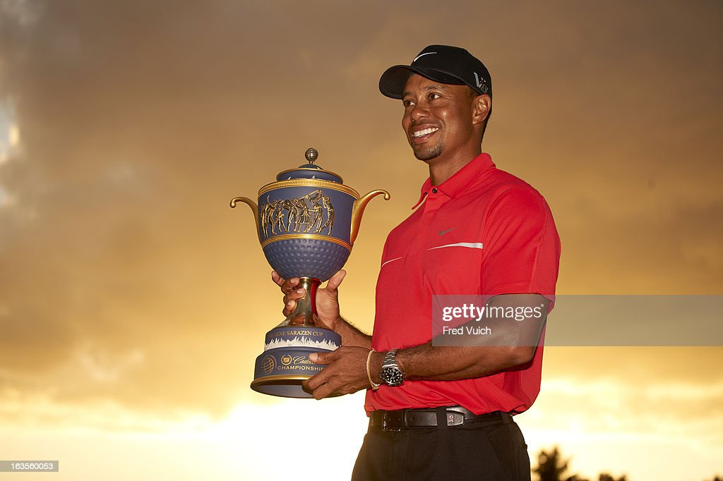 Tiger Woods victorious with Gene Sarazen Cup trophy after winning tournament on Sunday at TPC Blue Monster Course of Doral Resort & Spa. Fred Vuich F184 )