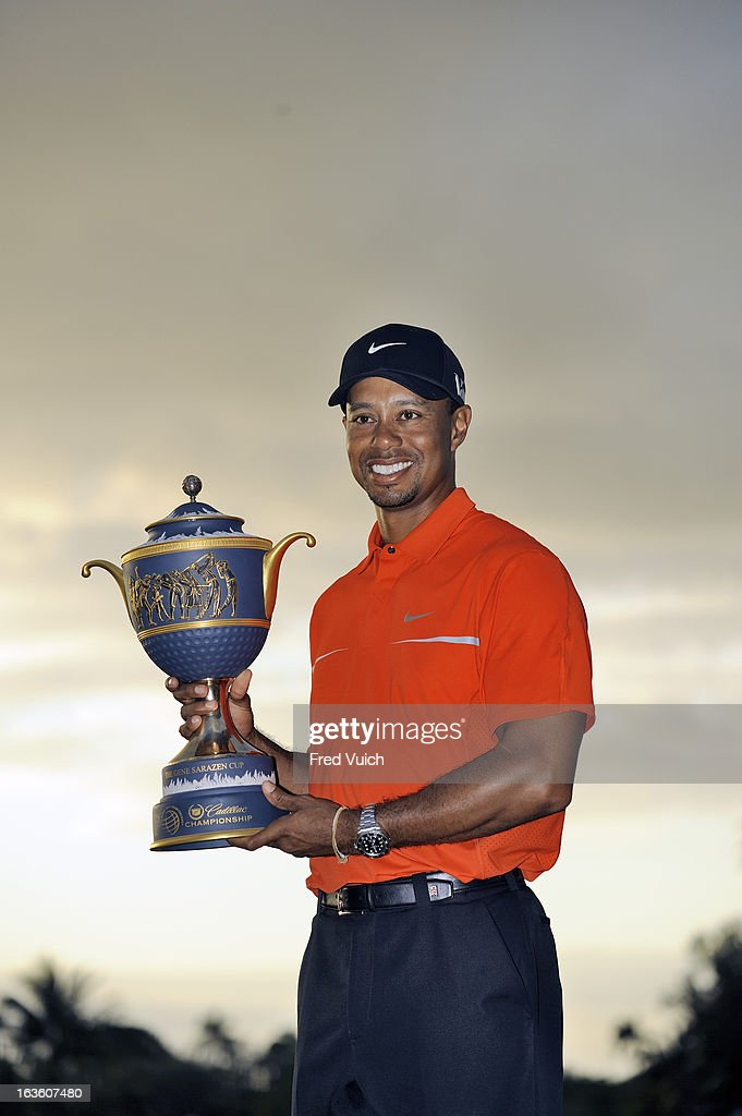 Tiger Woods victorious with Gene Sarazen Cup trophy after winning tournament on Sunday at TPC Blue Monster Course of Doral Resort & Spa. Fred Vuich F164 )