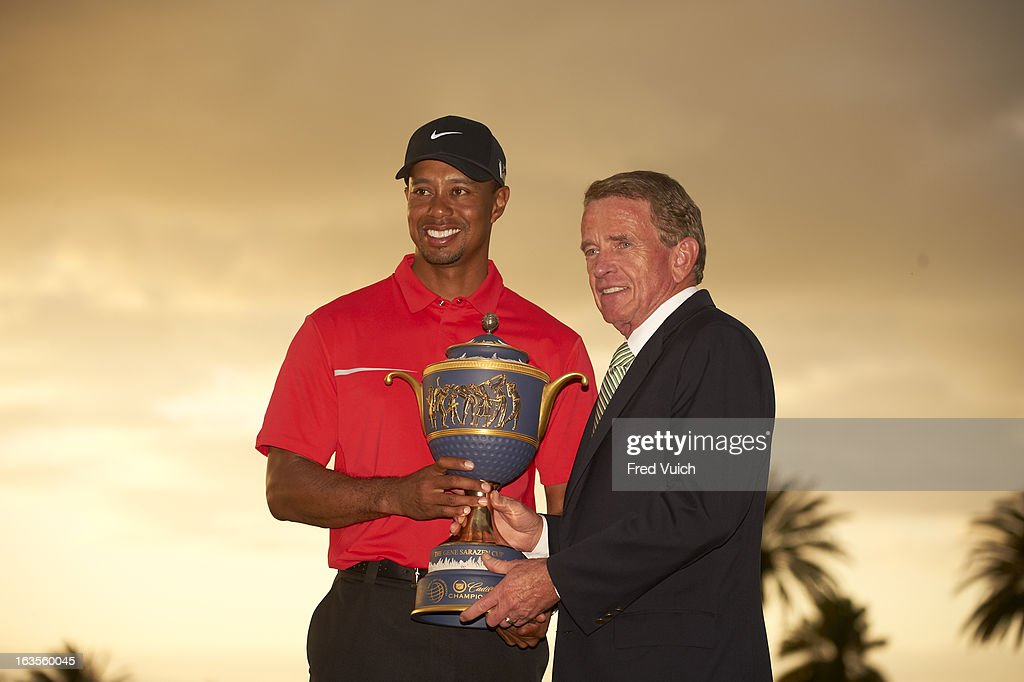Tiger Woods victorious with PGA Tour commissioner Tim Finchem, holding Gene Sarazen Cup trophy after winning tournament on Sunday at TPC Blue Monster Course of Doral Resort & Spa. Fred Vuich F172 )