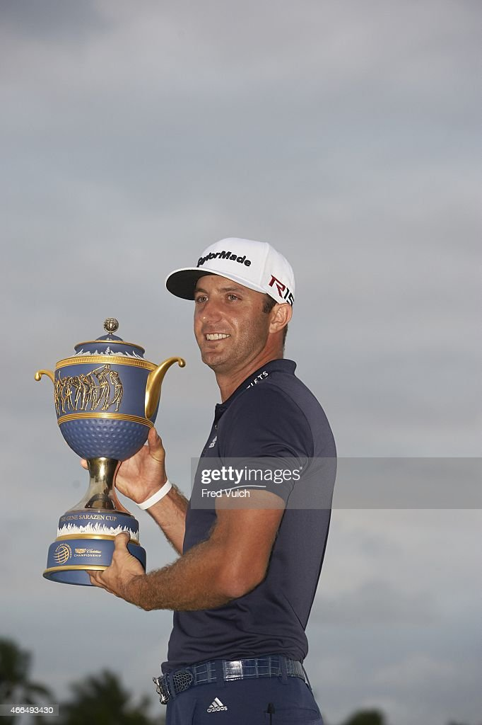 View of Dustin Johnson, victorious with Gene Sarazen Cup trophy after winning tournament on Sunday at TPC Blue Monster Course of Trump National Doral Miami. Fred Vuich TK4 )
