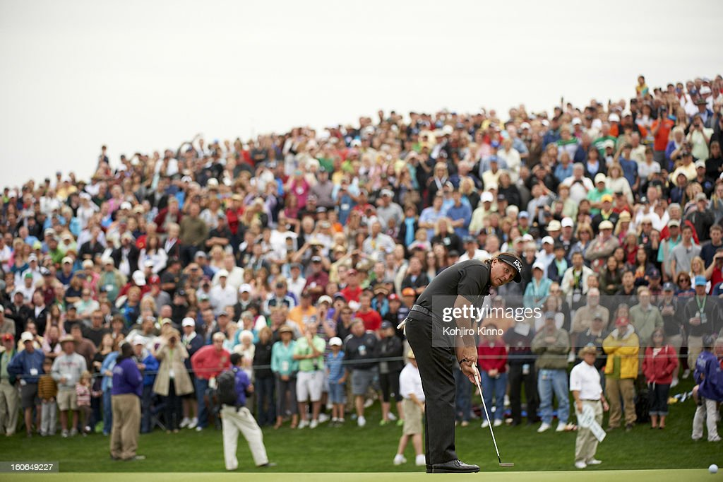 Phil Mickelson in action, putt from No 18 green during Sunday play at TPC Scottsdale. Kohjiro Kinno F603 )
