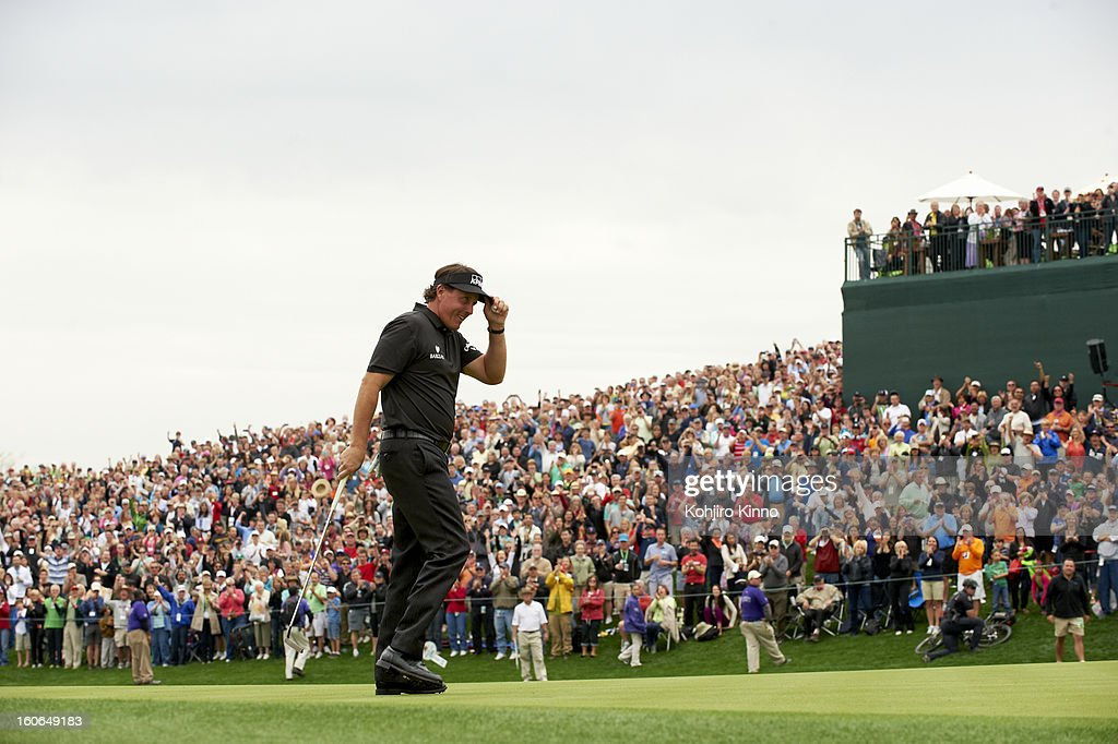Phil Mickelson victorious after sinking putt on No 18 green during Sunday play at TPC Scottsdale. Kohjiro Kinno F104 )