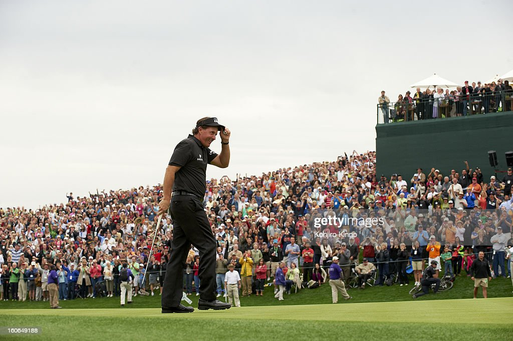 Phil Mickelson victorious after sinking putt on No 18 green during Sunday play at TPC Scottsdale. Kohjiro Kinno F105 )