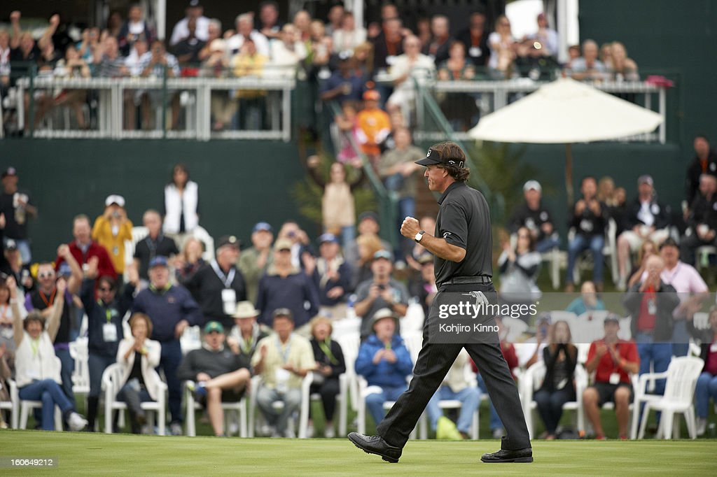 Phil Mickelson victorious on No 17 green during Sunday play at TPC Scottsdale. Kohjiro Kinno F572 )